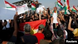 Syrian Kurds protest the Turkish offensive against Syria during a demonstration in front of the United Nation Headquarter in Erbil, Iraq Oct. 10, 2019.