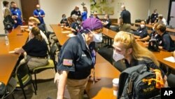 A nurse from Maryland chats with a nurse from Chattanooga, Tenn., as nearly three dozen health care workers from around the country arrive to help supplement the staff at Our Lady of the Lake Regional Medical Center in Baton Rouge, Aug. 2, 2021.