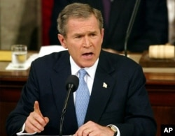 FILE - President George W. Bush delivers a State of the Union address to Congress on Capitol Hill in Washington, Jan. 29, 2002.