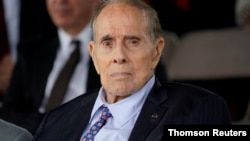 FILE PHOTO: Bob Dole attends welcome ceremony in honor of new Joint Chiefs Chairman Milley at Joint Base Myer-Henderson Hall, Virginia