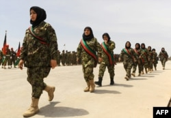 Afghan women soldiers march during the 22nd anniversary of the victory of the Afghan Mujahideen, in Herat on April 28, 2014.