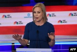 FILE - Democratic presidential hopeful U.S. Senator for New York Kirsten Gillibrand speaks during the second Democratic primary debate of the 2020 presidential campaign at the Adrienne Arsht Center for the Performing Arts in Miami, June 27, 2019.