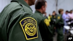 FILE - U.S. Customs and Border Protection agents hold a news conference in Donna, Texas, May 2, 2019.