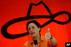 FILE - Former Sandinista revolutionary commander Dora Maria Tellez, president of the Sandinista Renewal Movement, speaks during the party meeting in Managua, Nicaragua, Aug. 21, 2005.