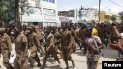Ethiopian government soldiers and prisoners of war in military uniforms walk through the streets of Mekelle, the capital of Tigray region, Ethiopia, July 2, 2021.