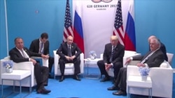 Trump, Putin Appear to Enjoy First Meeting as G-20 Protests Flare