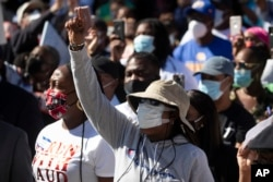 FILE - Demonstrators rally to protest the shooting of Ahmaud Arbery, in Brunswick, Georgia, May 8, 2020.