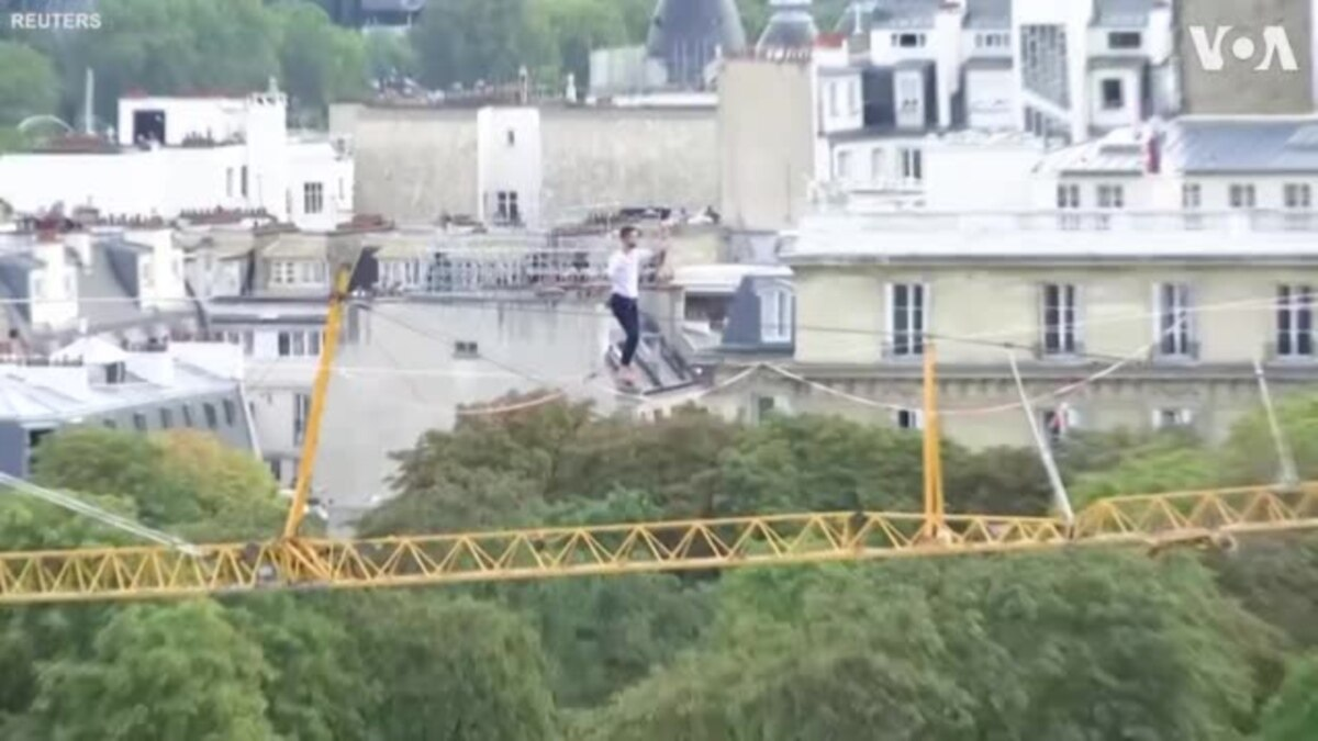 Barefoot Rope Walker Scales the Heights From the Eiffel Tower