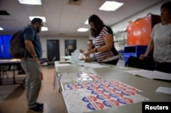 Voters sign in to cast their ballot at a polling place in Philadelphia, Pennsylvania, April 26, 2016.