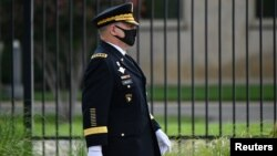 FILE - U.S. Chairman of the Joint Chiefs of Staff General Mark Milley walks outside the Pentagon, in Arlington, Virginia, Sept. 11, 2020.