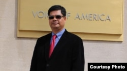 In this file photo - Nem Chhoeung, president of the Khmer Town Association, based in Georgia, posed in front of Voice of America quarters, Washington DC.