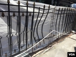 The fence near the Erawan shrine, blasted outward by the bomb explosion. (Steve Herman/VOA News)