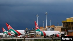 FILE - Kenya Airways planes are seen parked at the Jomo Kenyatta International Airport near Kenya's capital, Nairobi, April 28, 2016.