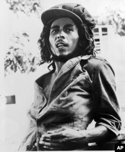 FILE - 1976 photo originally released by Island Records shows Jamaican reggae singer Bob Marley.