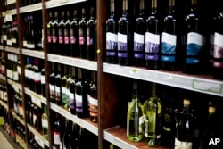 Wine bottles manufactured in a Jewish settlement in the West Bank on display at a supermarket in Jerusalem Wednesday, Nov. 11, 2015.