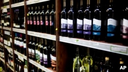 FILE - Wine produced in a Jewish settlement in the West Bank is seen on display at a supermarket in Jerusalem Nov. 11, 2015.