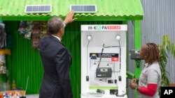 President Barack Obama looks at a solar power exhibit during a tour of the Power Africa Innovation Fair, Saturday, July 25, 2015, in Nairobi, Kenya. In Nigeria, Lumos Global is among the firms rolling out solar power technology. The company received finan