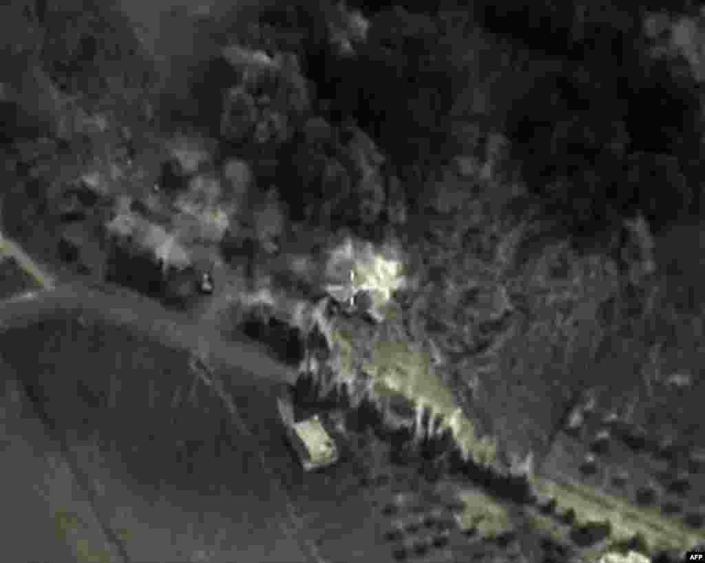 A video grab from Sept. 30, 2015, shows an image made available on the Russian Defense Ministry's official website, purporting to show an airstrike in Syria.