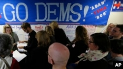 FILE - Democratic Party volunteers get instructions for canvassing neighborhoods, Nov. 4, 2016, following a get-out-the-vote rally at a campaign office in Seattle. Democrats see local mobilization efforts as key to prevailing over Republican candidates in the 2018 midterm elections.