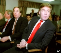 Billionaire developer Donald Trump, right, waits with his brother Robert for the start of a Casino Control Commission meeting in Atlantic City, N.J., March 29, 1990.