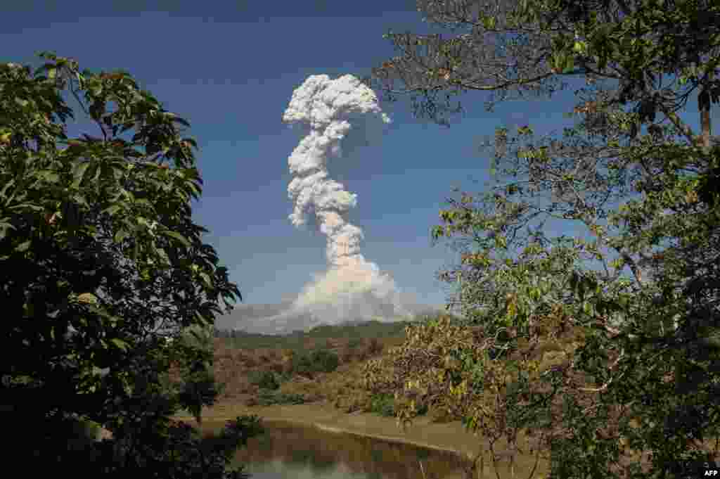 The Colima or Fuego volcano spews ash and smoke, January 23, 2017, as seen from San Antonio, Colima State, Mexico.
