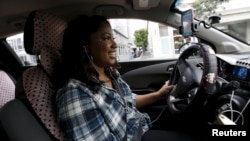 Maya Jackson, a Lyft driver from Sacramento, looks for customers during a photo opportunity in San Francisco, California February 3, 2016. (REUTERS/Stephen Lam)