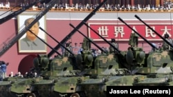 China, Beijing, Anti-aircraft artilleries drive past Tiananmen Gate during a military parade to mark the 70th anniversary of the end of World War Two