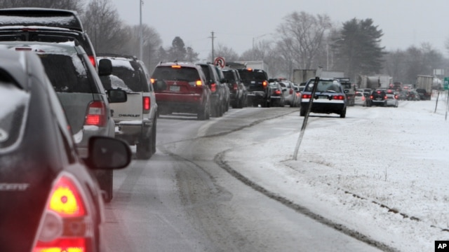 Cars are stuck in traffic as a winter storm arrives, in Newington, New Hampshire, Feb. 8, 2013.