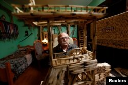 Janusz Urbansk looks on as he sits among his matchstick sculptures in his flat in Ruda Slaska, Poland, May 4, 2016.