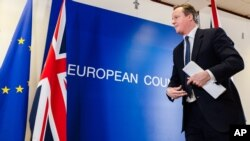 Thủ tướng Anh David Cameron sau một cuộc họp báo tại hội nghị thượng đỉnh EU ở Brussels, 19/2/2016.