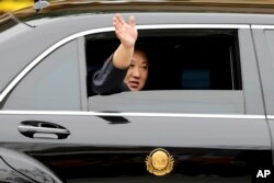North Korean leader Kim Jong Un waves from a car after arriving by train in Dong Dang, a Vietnamese border town, Feb. 26, 2019, ahead of his second summit with U.S. President Donald Trump.