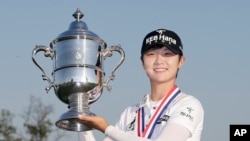 South Korea's Sung Hyun Park holds up the championship trophy after winning the U.S. Women's Open Golf tournament, July 16, 2017.