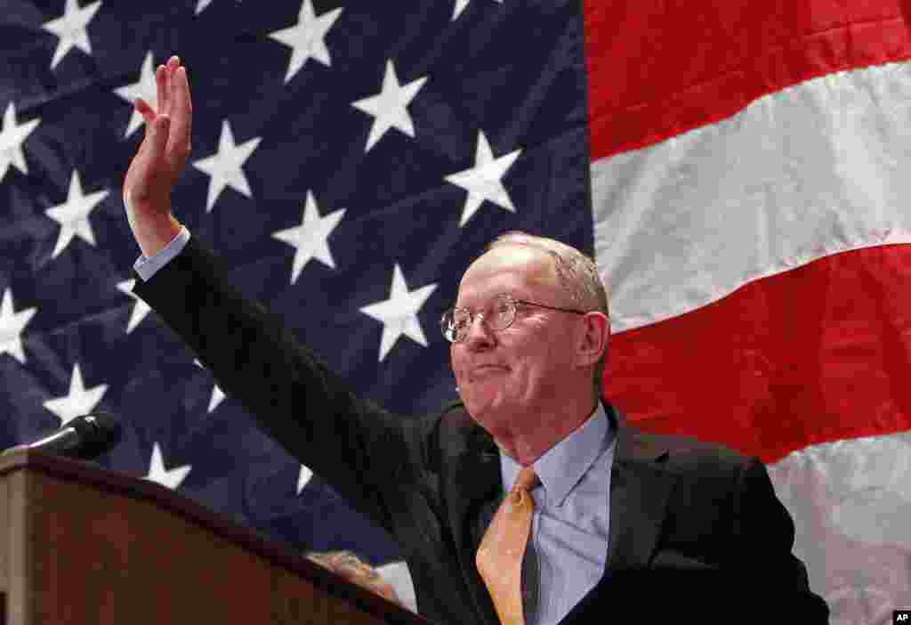 Sen. Lamar Alexander, R-Tenn. waves after speaking to supporters, Nov. 4, 2014, in Knoxville, Tenn.