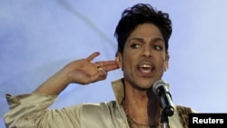 FILE - Prince performs at the 2011 Hop Farm Festival in southern England July 3, 2011.
