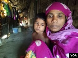 "Rohingya refugee woman Noor Ayesha and her 5-year-old daughter at a Rohingya colony in Cox's Bazar, Bangladesh. ""[During the military operation] the soldiers burnt alive my five children. They raped my two other daughters in front of me, before killing them. They also shot dead my husband...I shall never return to this country which is a hell for all Rohingyas,"" Ayesha told VOA. (S. Ullah/VOA)"