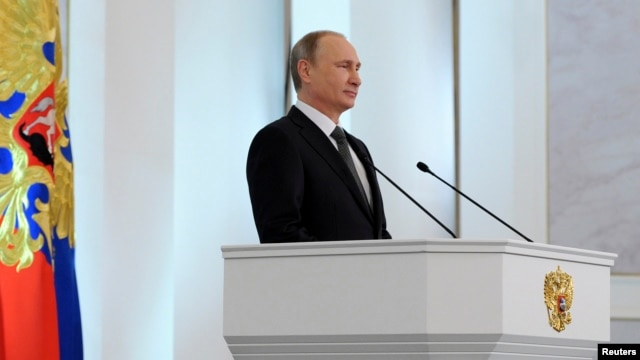 Russia's President Vladimir Putin delivers his annual state of the nation address to the Federal Assembly at the Kremlin in Moscow, Dec. 4, 2014.