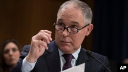 FILE - Environmental Protection Agency Administrator-designate, Oklahoma Attorney General Scott Pruitt testifies on Capitol Hill in Washington at his confirmation hearing.