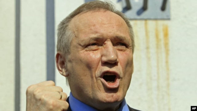 Former presidential candidate Vladimir Neklyaev gestures as he speaks to the media after leaving a court building in Minsk, Belarus, May 20, 2011