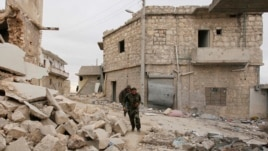 Free Syrian Army fighters run to avoid snipers loyal to Syria's President Bashar al-Assad, in Aleppo, Dec. 4, 2013.