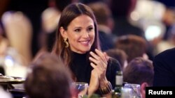 FILE - Jennifer Garner claps during the 32nd American Cinematheque Award ceremony honoring Bradley Cooper in Beverly Hills, California, Nov. 29, 2018.
