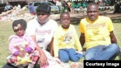 Sheffra Dzamara and her children with a member of Occupy Africa Unity Square in Harare. (Photo: Charles Nyoni)