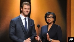 From left, Chris Hemsworth and President of the Academy Cheryl Boone Isaacs announce the Academy Awards nominations at the 86th Academy Awards nomination ceremony, Jan. 16, 2013 in Beverly Hills, Calif.