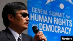 FILE - Blind Chinese dissident Chen Guangcheng addresses the sixth Geneva Summit for Human Rights and Democracy after receiving its first Courage Award, in Geneva, Feb. 25, 2014.
