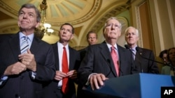 Senate Republican leaders, from left, Sen. Roy Blunt, R-Mo., Sen. John Barrasso, R-Wyo., Sen. John Thune, R-S.D., Senate Minority Leader Mitch McConnell, R-Ky., and Senate Minority Whip John Cornyn, R-Texas, meet with reporters, at the Capitol in Washington, July 29, 2014.