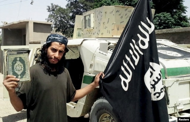 FILE - Belgian national Abdelhamid Abaaoud, shown in an undated photo published in the Islamic State's online magazine Dabiq, was believed to be the mastermind of the deadly attacks on Paris, Nov. 13, 2015. He bragged of slipping back into Europe from Syria.