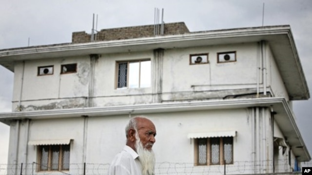 A resident walks past the compound where U.S. Navy SEAL commandos killed Osama in Abbottabad, Pakistan, May 5, 2011