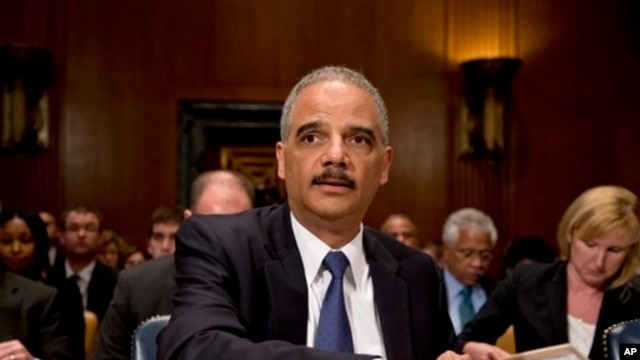 Attorney General Eric Holder prepares to testify before a Senate Appropriations subcommittee on Capitol Hill, Washington, June 6, 2013.