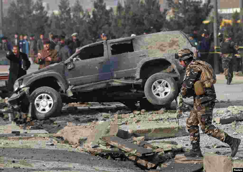 Afghan security forces inspect the site of a blast in Kabul.