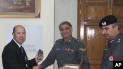 U.S. Assistant Secretary David Johnson and Embassy Islamabad Deputy Chief of Mission Gerald Feierstein donate communications equipment to the North Western Frontier Province police.