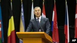 FILE - Milo Djukanovic, Montenegro's prime minister at the time, speaks at a NATO Parliamentary Assembly session in Tirana, Albania, May 30, 2016.